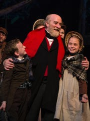 """Joshua Cross, Jed Diamond and Annika Kallstrom in the Clarence Brown Theatre's production of """"A Christmas Carol."""""""