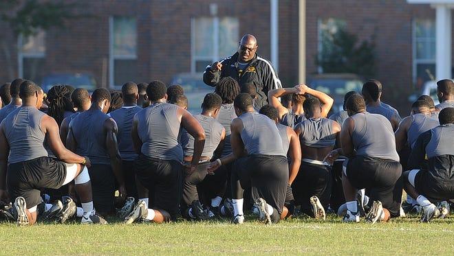 "Interim head coach Dennis ""Dirt"" Winston speaks to his team during practice at Grambling State University Oct 21, 2013."