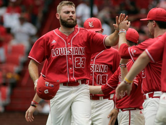 Ragin' Cajuns' Stefan Trosclair high fives teammates