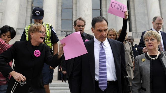 Protesters heckle Lehman Bros. chief Richard Fuld as he leaves Capitol Hill in October 2008.