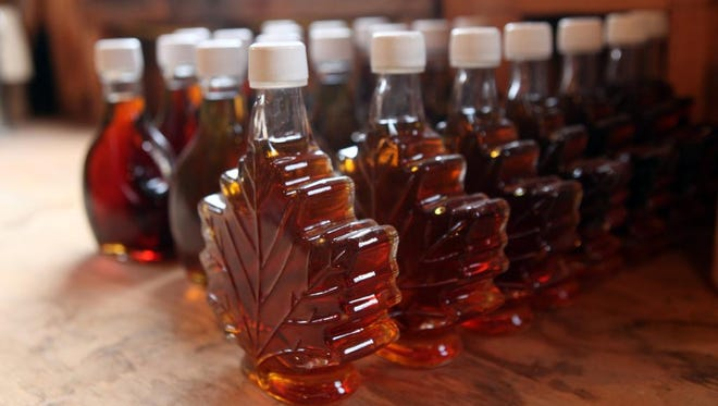 Bottles of pure maple syrup made at the Sugarhouse at White Oak Farm are lined up in March 19, 2014 in Yorktown. Bri Hart owns the farm and said the cold weather has adversely affected the flow of maple sap this year.