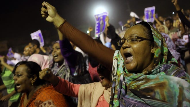Sudanese anti-government protesters chant slogans during a demonstration in Khartoum, Sudan, on Sunday.