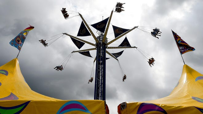 Children swing on the Vertigo ride during the Monroe County Fair in 2019. The 2020 fair has been canceled for the first time in the event's 73-year history.