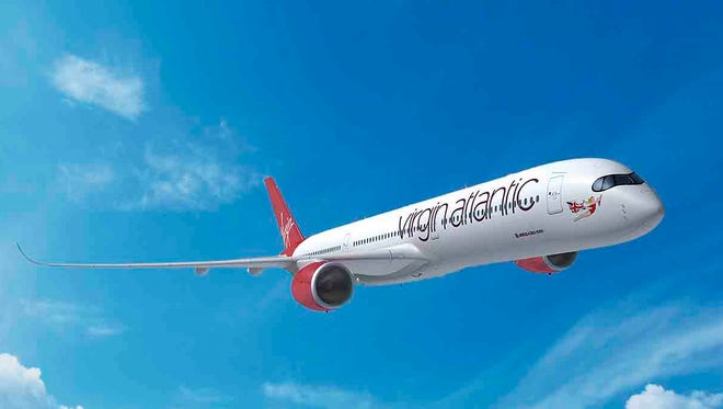 This rendering provided by Airbus shows an Airbus A350-1000 in the Virgin Atlantic paint scheme.