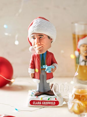 A Clark Griswold bobblehead from Urban Outfitters would make a great white elephant gift.
