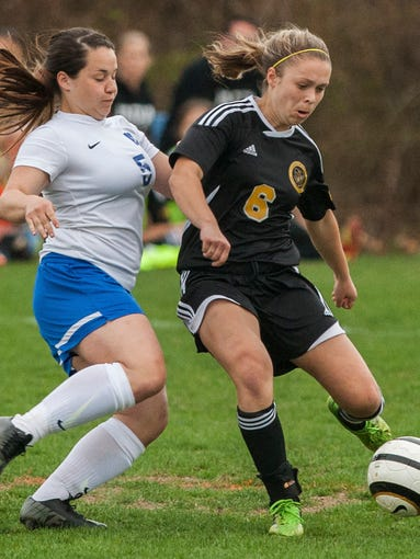 Padua's Sarah Brush (No. 6) looks to pass in front of A.I.'s Claudia Marshall (No. 5) in the first half of Padua's 1-0 win over A.I. at A.I. duPont High School on Monday evening, April 14, 2014.