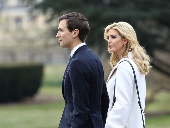 Ivanka Trump and Jared Kushner walk across White House