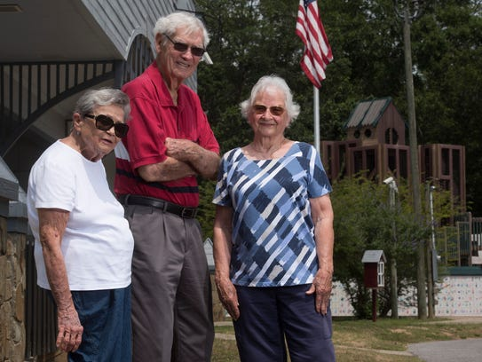 """Pace area residents Peggy Gale, left, Bill Bone and his wife, Mary Louise Bone, are seeking support from the Santa Rosa County Commission to use the facilities at Benny Russell Park as a """"senior center."""""""