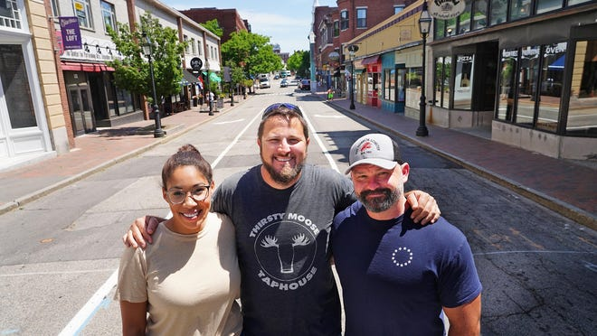 "Portsmouth restaurant owners ""Jo"" Kelley, Joe Kelley, and Al Fleury stand on Congress Street  Thursday, and they have a plan to close four Market Square streets for outdoor dining and shopping. They have hired an engineer to show how it can work and are hoping city officials can make it happen."