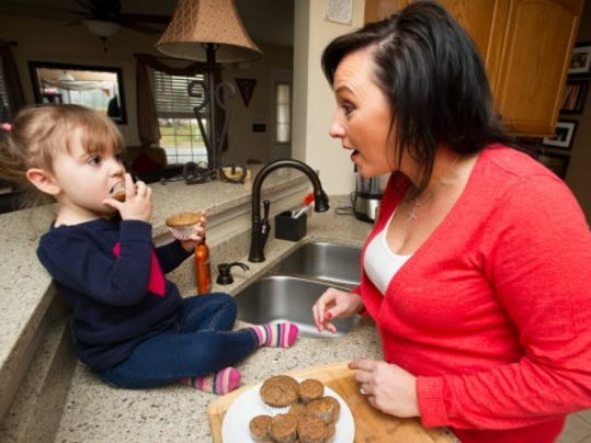 Freda, 18 months, munches on a muffin made by her mother, Maria Bocchiaro, at their Conewago Township home. (Photos by Paul Kuehnel)