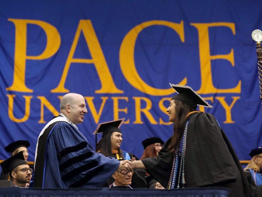 Pace University President Marvin Krislov congratulates graduate Maria Loughitano after she received her diploma during commencement ceremonies at Pace's Pleasantville campus May 16, 2018.