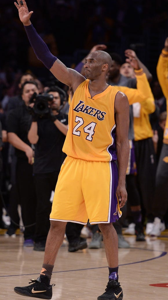 Los Angeles Lakers forward Kobe Bryant (24) waves to