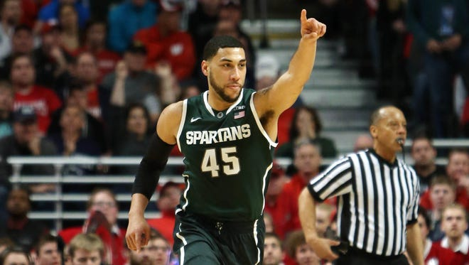 Michigan State guard Denzel Valentine reacts after a made basket against the Wisconsin Badgers.