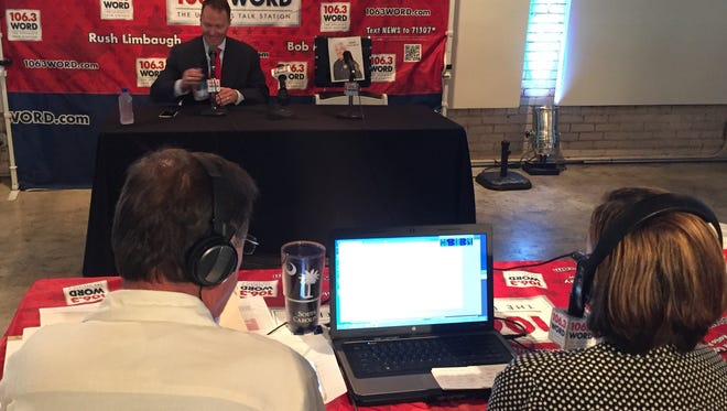 Greenville County sheriff's candidate Will Lewis is interviewed by Bob McLain and Tara Servatius of 106.3 FM Wednesday night at the Zen event forum in downtown Greenville.