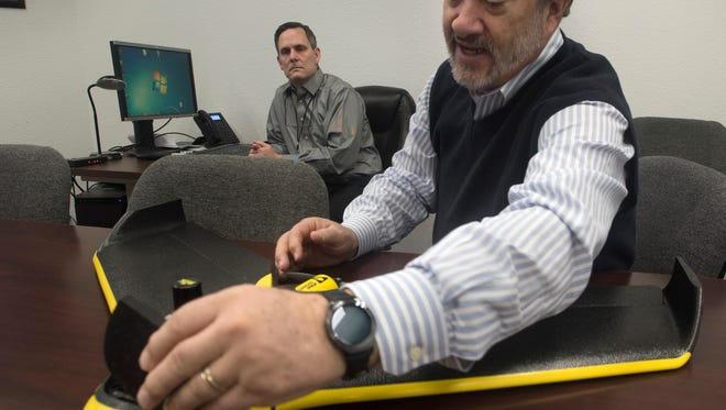 Santa Rosa County Property Appraiser Greg Brown, right, and Karl Sandell, general counsel and director of programming, talk Tuesday, Jan. 10, 2018, about the department's use of drones to collect up-to-date property data.