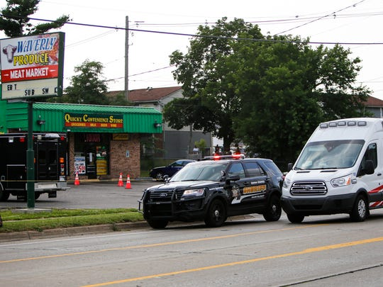 Police and sheriff officials at the scene of a shooting Tuesday evening, July 11, 2017. Trevon McDuffy was shot and killed on South Waverly Road in Delta Township about 4:32 p.m.