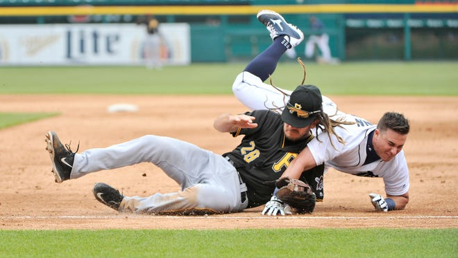 James McCann collides with Pirates first baseman Jason Jaso in the fifth inning Monday.