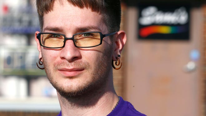 Kevin Kincaid-Shoaf is the president of the Mansfield Gay Pride Association. He stands in front of Sami's Bar on Thursday afternoon.