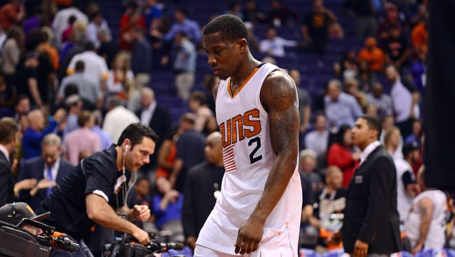 Suns guard Eric Bledsoe (2) leaves the court after facing the Houston Rockets at US Airways Center. The Rockets won 127-118.