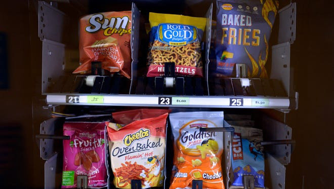 Snacks inside a Dynamic Healthy Vending machine range from baked chips to fruit chews.