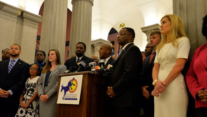 Rep. Todd Rutherford speaks to the media inside the Statehouse on Tuesday, July 7, 2015. Rutherford says they have enough votes to pass a clean bill to remove the flag from the Statehouse grounds.