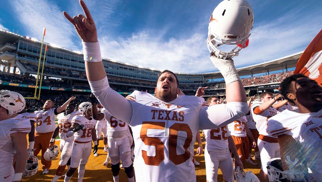 Texas Longhorns offensive lineman Jake Raulerson celebrates the win over the Baylor Bears at McLane Stadium.