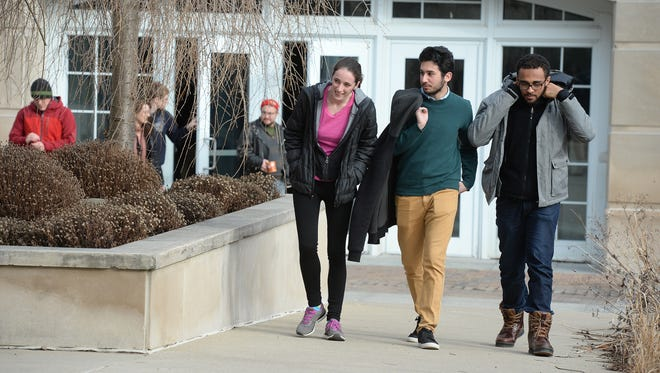 Students exit the Earlham College Athletic and Wellness Center after a meeting on diversity at the Richmond school in February 2016.