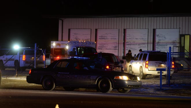 Richmond police are joined by the Wayne County Sheriff's Department and Indiana State Police to investigate a shooting Wednesday, Feb. 10, 2016, on Industries Road.