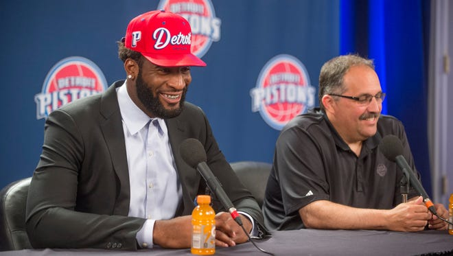 Pistons center Andre Drummond speaks while sitting next to president and coach Stan Van Gundy during a press conference at the Palace at Auburn Hills on Friday, July 15, 2016.