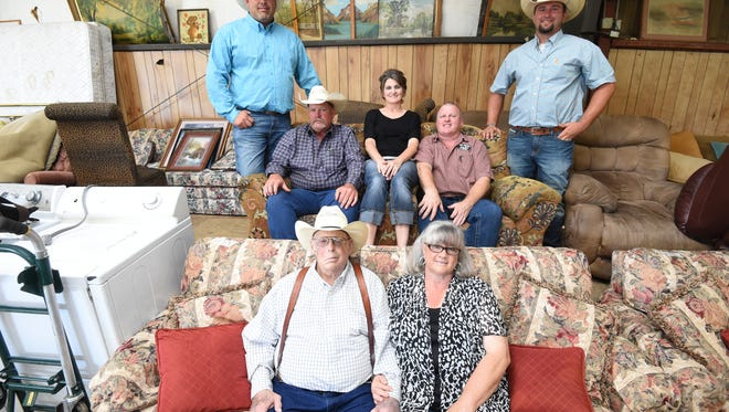The Walker family is all in when it comes to the family business Walker Auction. Up front are Tommie and Karen Walker while the back row includes, from left, Tommie Walker III, Tommie Walker Jr., Tammy Barnes, Tim Walker and Chase Walker. Not pictured are Justin Walker who runs the office and Brandon Barnes who serves as an auctioneer.