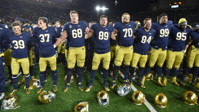 Nov 19, 2016; South Bend, IN, USA; The Notre Dame Fighting Irish sing their alma mater after a game against the Virginia Tech Hokies at Notre Dame Stadium. Virginia Tech won 34-31.