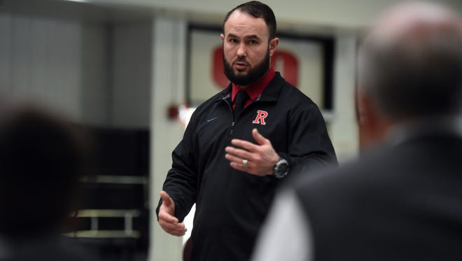 Richmond High School's new football coach Abe Tawfeek presents his coaching philosophy Thursday, March 16, 2017 as the athletic department hosts a 'Meet and Greet' event in the school's cafeteria.