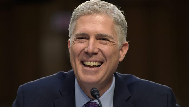 Supreme Court Justice nominee Neil Gorsuch smiles as he testifies on Capitol Hill in Washington on March 21, 2017, during his confirmation hearing before the Senate Judiciary Committee.
