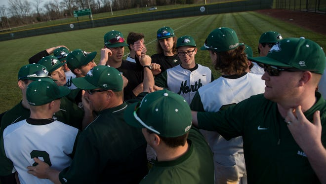 North coach Jeremy Jones (center) and the rest of the team huddles up after defeating Bosse at North High School on Wednesday, April 11, 2018.