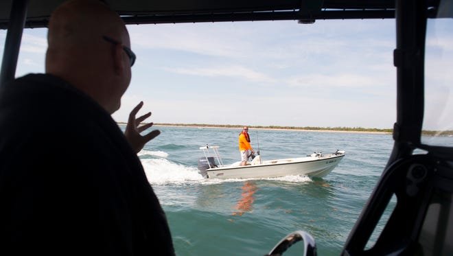 "Martin County Sheriff's Office Deputy Mike Joseph (left) chats with boater John Barca as they head into the Indian River Lagoon on Friday, May 11, 2018 through the St. Lucie Inlet in Martin County. Joseph and other deputies will be heavily patrolling the waterways around the Memorial Day holiday, where Joseph estimates over a thousand people will be celebrating at the Stuart sandbar. ""You want everybody to have a good time, but you want everybody to be safe too,"" Joseph said. For a holiday, the focus is ""sandbars and safety."""
