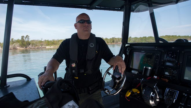 "Martin County Sheriff's Office Deputy Mike Joseph patrols the Indian River Lagoon and Atlantic Ocean on Friday, May 11, 2018 in Martin County. Joseph and other deputies will be heavily patrolling the waterways around the Memorial Day holiday, where Joseph estimates over a thousand people will be celebrating at the Stuart sandbar. ""You want everybody to have a good time, but you want everybody to be safe too,"" Joseph said. For a holiday, the focus is ""sandbars and safety."""