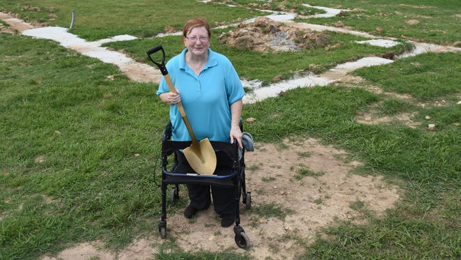 Nancy Neaves stands in the backyard of her future house on Walnut Street in Gassville. Neaves is a participant in the Mutual Self-Help Housing Project administered by the Northwest Regional Housing Authority.