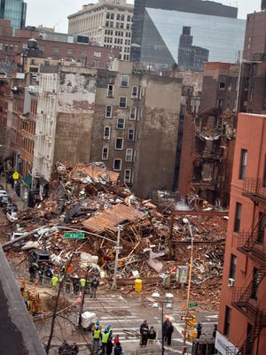Debris in the aftermath of a building collapse following an explosion and fire in the East Village neighborhood in New York on  March 27. Authorities say two people are unaccounted for following an apparent gas explosion that leveled three buildings.
