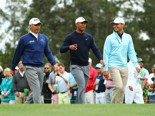 Fred Couples, Tiger Woods and Matt Parziale walk off