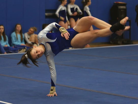 Mahopac's Callie Johanson competes in the floor exercise