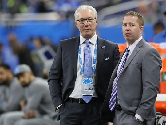 Detroit Lions president Rod Wood, left, and general manager Bob Quinn watch warmups prior to the game against the Green Bay Packers on Dec. 31, 2017 at Ford Field.