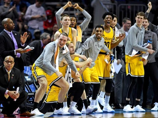Former Rider standout Max Portmann (foreground) had a front-row seat to the biggest upset in NCAA Tournament history Friday night as UMBC upset No. 1 Virginia.