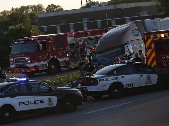 Safety forces work at the scene of a multiple-vehicle