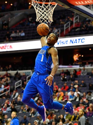 Dallas Mavericks guard Dennis Smith Jr. (1) dunks the ball against the Washington Wizards during the first half at Capital One Arena.