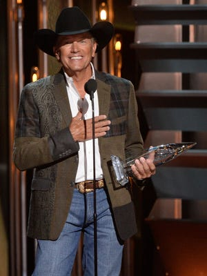 George Strait wins for entertainer of the year at the 47th annual CMA Awards.