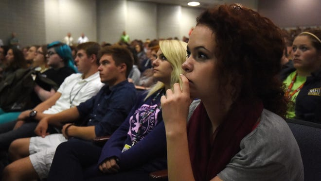 Mountain Home High School senior Rheagan Hill and classmates listen today to Rachel's Challenge, a program about spreading kindness. Rachel Scott was the first student killed in the 1999 Columbine High School shootings.