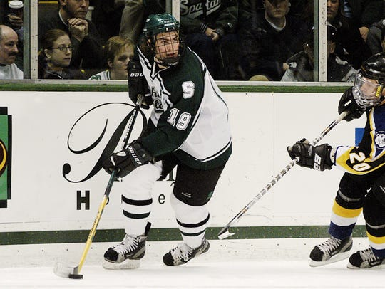 Jim Slater (19) of the MSU hockey team skates during