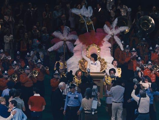 Billie Jean King (Emma Stone) makes a flamboyant entrance