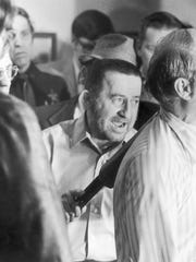 Tony Kiritsis talks to the media just priot to releasing his hostage Richard Hall.  Feb. 10, 1977 after a three-day standoff with police.