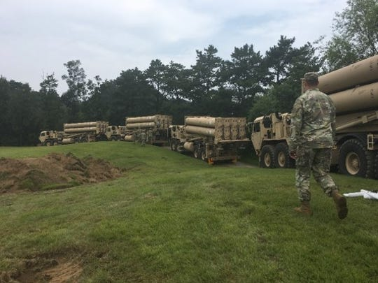 Four THAAD launchers move to their emplacement sites after a 110-mile convoy.